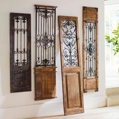 Our Vintage Gate artwork is crafted from generously distressed wood and metal. The rustic wooden frame and inset fleur-de-lis gate finials resemble a found artifact that is sure to complement most any decor. Crafted from distressed wood and metal Resembles an antique Metal gate finials detailed with scrolling and fleur-de-lis details Arrives ready to hang Not recommended for outdoor use