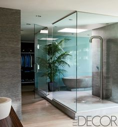 Breathtaking Celebrity Bathrooms  On Set  The serene master bath in filmmaker Michael Bay's Miami Beach home is sheathed in etched-stone tiles; the bathtub is cast concrete, and the shower fittings are by Boffi.