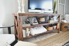decorated console | As far as styling this lovely TV console, I keep moving stuff around ...