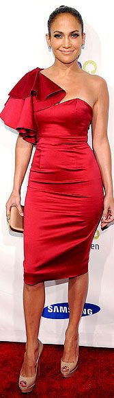 #Jennifer_Lopez wearing a one-shouldered littler red dress with ruffle shoulder detail for the red carpet • #LRD