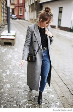Street look with blue jeans, black top and grey coat