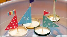 What kid wouldn't love these little boats? They are super easy & fun to make. All you need are some jar lids, glue gun, fabric & barbecue sticks.