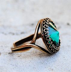 Emerald Ring, Swarovski Crystal Ring - Crown Victorian - Emerald Green and Antiqued Brass Adjustable Ring. $32.50, via Etsy.