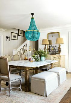 pop of color --chandelier, the upholstered benches, marble table top.