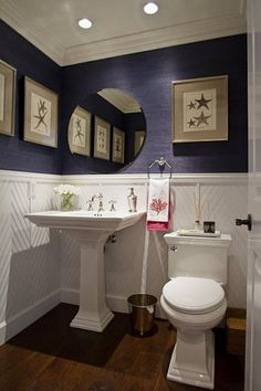 for navy blue and pink bathroom - white wainscotting on bottom, navy blue paint up top
