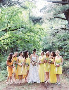Mismatched yellow bridesmaids dresses.