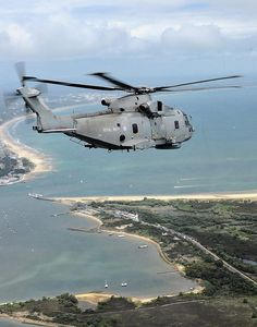 Royal Navy Merlin Helicopter Flying Over South Coast of England by Defence Images