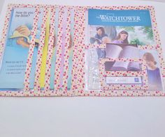 Medium weight plastic literature cover with ribbon piping in an array of colors. Holds Tracts, Watchtowers, Awakes, Meeting invites, Website cards, and Brochures. Great JW ministry organizer.