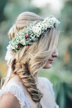 Wear your hair twisted into a braid top with a ring of fresh flowers.