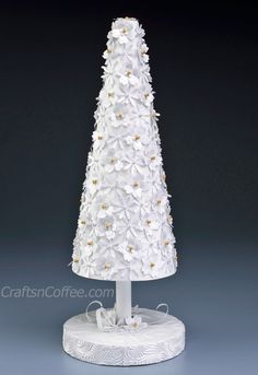 Love this! It's easy to make with paper punches and a Styrofoam cone. Tutorial on CraftsnCoffee.com.