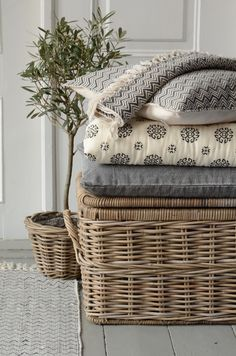 Love Love Love this basket, holding blankets, throws and cushions. Perfect for a cosy country cottage. Love the modern prints on the fabric too.  If you like this, why not head on over to www.FlorenceAndFreya.com for more modern country design inspiration, plus get FREE access to our home design resource library.