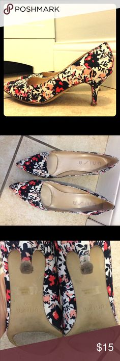 Floral heels Small heel floral pattern. Background is white with navy blue and varying pink to salmon color flowers. The shoes are a canvas fabric. Worn no more than 10 times. Shoes Heels