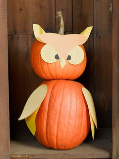 Owl Pal Pumpkin        Two pumpkins, glue, paper, scissors, and a few straight pins are all you need to create this wide-eye friend. First stack a round pumpkin (for the head) on top of a larger, oblong pumpkin (for the body). (Secure with hot glue if needed.) Use our free patterns and construction paper to create the owl's clever features. Attach the pieces to the pumpkins using glue and pins.