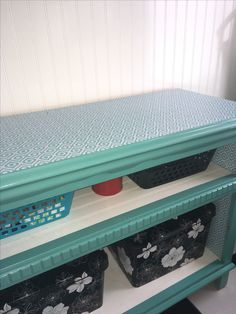 Upcycled dresser into a pet supply storage area! removed drawers and built shelf bottoms with bead board paneling, then placed cute bins in shelves for storage! Painted a pretty tiffany blue and added a fun contact paper pattern to the top for easy cleaning and durability