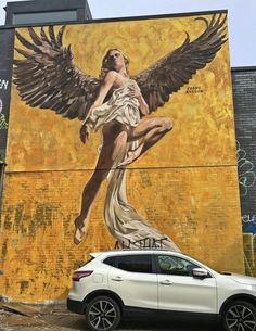 Cosmo Sarson's handpainted Angel of Brighton.   Visit more Brighton street art here : Mazcan, Cosmo Sarson, BrokeArt and many more #brighton #streetart #muralart #art #artist #graffiti
