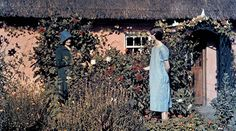 Two women talk in a cottage garden. Image: Clifton R. Adams / National Geographic.