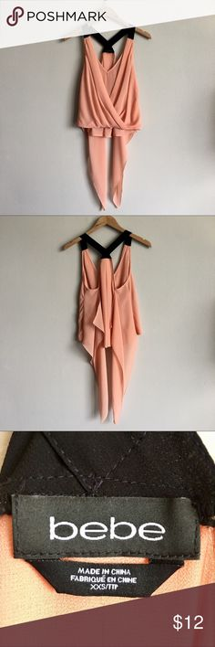 [84] BEBE Summer Blouse Beautiful and flowy Bebe summer blouse in an orange/salmon color. Worn once and has a relaxed fit. ‼️Price is final‼️ No trades🚫 bebe Tops Blouses