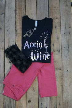 Adult Black Accio Wine tee. Being a Mother is difficult let alone being a Muggle. Don't you wish we could just sit back and wave our wand to bring our wine to us. Oh Well, At least we can look good in this tee.   graphic Tee Shirts, women's fashion tees, bella and Canvas, cotton shirts, women's fashion, spring fashion, summer fashion, shirt fashion,  disney lover, fairy tale, nursery rhymes, harry potter, hogwarts, always,