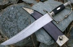 Seguin Bowie.Forged carbon steel blade with antique finish. Carved Nickel silver fittings.Ebony handle with escutcheon.Leather sheath with nickel silver fittings.