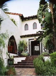 Spanish stucco house - COCOCOZY: TILE FILE: HOW A MOSAIC TILE FLOOR BRINGS INDOOR LIVING TO THE OUTDOORS!