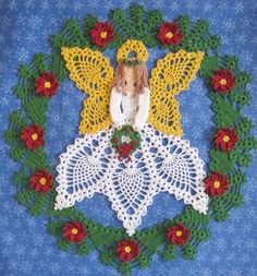 Angel within a holly & ivy wreath