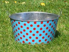 Rub a dub dub.  Aqua and red tub.