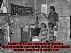 January 1939. Sharecropper mother teaching children numbers and alphabet at home in Transylvania, Louisiana. photo circa is January 1939