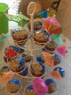 Beach cupcakes. I love the umbrellas.