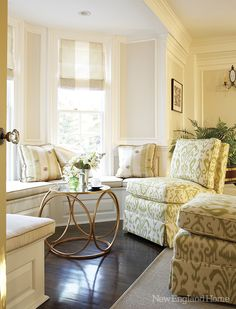 A sunny conversation area in the living room centers around a sculptural modern table.