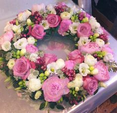 Pink and white funeral wreath.