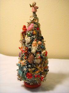 Miniature Christmas tree using vintage embellishments.
