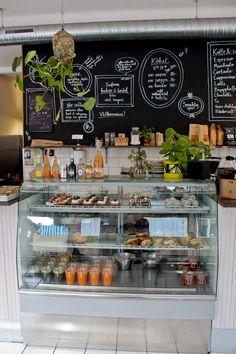 white tile, wood shelf, chalkboard.  hanging greenery.  Chez Madame | Malmö, Sweden