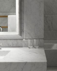 Mmmmm Carrara Marble. Cafe Royal Hotel: Twin sinks and sizable tubs carved from solid stone.