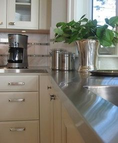 Stainless Steel Countertops/white Cabinets