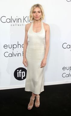 The British beauty adds some subtle shimmer to her look with this backless Calvin Klein dress.   - MarieClaire.com