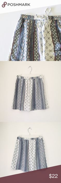 """Hollister Mixed Prints Skirt Painterly prints bring global chic to a light and easy mini skirt gathered to an elastic-waistband. 13"""" waist; 16.5"""" length; 24"""" hem. •Size S; True to size but could also work for a size M •Condition: New with tags •Pull-on style •100% viscose •No modeling/trades/swaps Hollister Skirts Mini"""