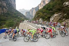 Cyclists rush toward a steep descent in the Gao Ya Kou mountain range during stage three of the 2012 Tour of Beijing. In its second year, the five-stage Tour of Beijing—part of the UCI WorldTour, which includes the Tour de France—wound past Chinese landmarks such as Tiananmen Square, the Bird's Nest Stadium, Summer Palace, the Great Wall, and the Ming Tomb Reservoir. Photograph by PatitucciPhoto http://adventure.nationalgeographic.com/adventure/
