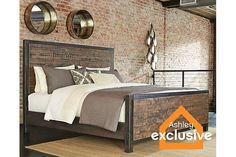 $893 Ashley. Rustic Brown Wesling King Panel Bed View 1