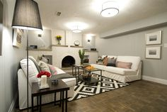 An old brick fireplace gets an upgrade of paint, Jeff & Kirsty Property ► Look at the fire place and the rug! Scott Mcgillivray, Income Property, Old Bricks, Brick Fireplace, Home Reno, Season 7, Porch Decorating, Sweet Home, Couch