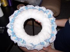 <3 Baby Diaper Wreath - (tutorial) Continue adding diapers until the entire ring is covered.