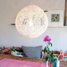 String ball chandelier....tutorial here http://decorate.tipjunkie.com/how-to-make-a-string-ball-chandelier-diy-light/