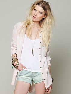 {Button Down} ---- light coloured button shirt featuring as jacket/cardigan over white top and light denim shorts