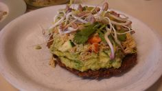 Essene Bread with tuna, spicy guac, sprouts and veggies