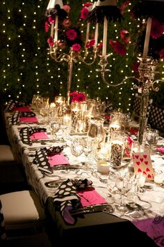 "Table settings inspired by Lewis Carroll's ""Alice in Wonderland"" were designed for the wedding dinner."