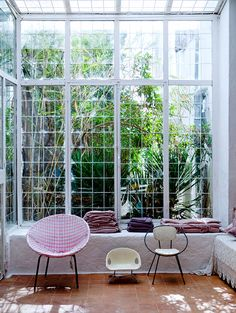 bohemian modern indoor outdoor room with glass wall and ceiling photographed by julie ansiau. / sfgirlbybay
