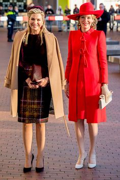 Queen Máxima of the Netherlands, left, went for a preppy look with a purple velvet long-sleeved top and a tartan skirt, throwing on a camel coat to ward off the winter chill.  While Queen Mathilde of Belgium on right opted for a bold scarlet ensemble made up of a tailored coat dress and a broad-rimmed hat.  She offset the bold color palette with neutral accessories, wearing a pair of cream Mary Janes and a matching clutch.