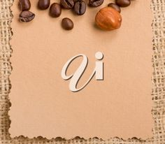 Royalty Free Photo of a Piece of Paper and Coffee Beans Coffee Beans, Royalty Free Photos, Place Cards, Place Card Holders, Stock Photos, Paper, Brown, Chocolates, Brown Colors