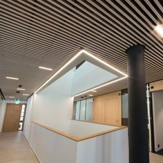 The freedom in slat size and gap with our Solid Wood grill ceilings provides flexibility in budget and design at Raiffeisenbank in Echallens, Switzerland. #architecture #woodceiling #solidwood #grillceiling #buildingdesign #architecturaldesign #architecturephotography #moderndesign
