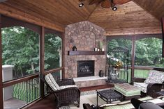 Four & Three Season Porch - love fireplace, floor, ceiling and fan and trimmed windows everywhere.