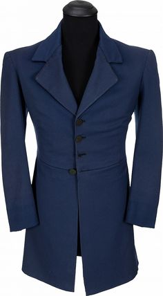 """A Clark Gable Period Coat Made for """"Gone With The Wind."""" Metro-Goldwyn-Mayer, 1939. Navy blue wool, single-breasted, four button front closure, back with pleats and two buttons at waist, black satin lining, 'Western Costume Corp.' label reads in part """"42 1668 / Clark Gable,"""" further 'W.C.C.' stamps on right sleeve lining; made for the actor to wear as """"Rhett Butler"""" but rejected by producer David O. Selznick; interestingly, it was worn by Gable in the Metro-Goldwyn-Mayer 1941 film, """"Honky…"""